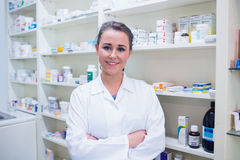 Portrait of a smiling student in lab coat with arms crossed royalty free stock image
