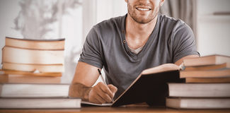 Portrait of smiling student preparing for exam Royalty Free Stock Photos
