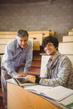 Portrait of smiling student with professor. In classroom Stock Images