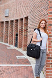 Portrait of a smiling student standing up. Outside a building Stock Image