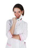 Portrait of smiling successful young female doctor. Isolated on a white background Stock Photos