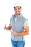 Portrait of smiling supervisor writing on clipboard. On white background Royalty Free Stock Photography