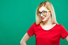 Portrait of Smiling Surprised Girl Wearing Red Top and Eyeglasses. Sensual Pretty Blonde with Long Hair is Posing on Royalty Free Stock Images