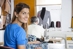 Portrait Of Smiling Tailor Using Sewing Machine Royalty Free Stock Photography