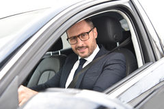Portrait of smiling taxi chauffeur stock images