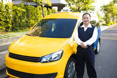 Portrait of smiling taxi driver with car Royalty Free Stock Images