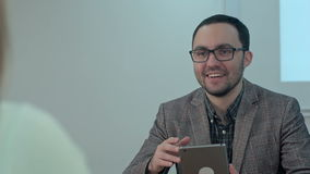Portrait of a smiling teacher with tablet in the class room stock video