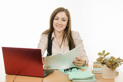 Portrait of a smiling teacher at your desk Stock Photo