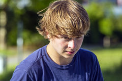 Portrait of a smiling teen boy in the open air Stock Photos