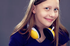 Portrait of a smiling teen girl with headphones Stock Image