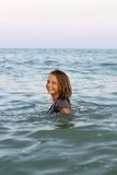 Smiling teen girl in the sea Stock Image