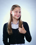 Portrait of a smiling teen girl showing thumbs up Royalty Free Stock Images