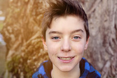 Portrait of a smiling teenage boy Stock Images