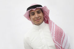 Portrait of smiling teenage boy in traditional Arab clothing, studio shot Stock Image