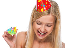 Portrait of smiling teenage girl in cap with party horn blower Royalty Free Stock Photo