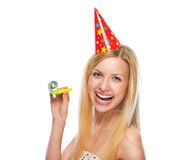 Portrait of smiling teenage girl in cap party horn blower Royalty Free Stock Image