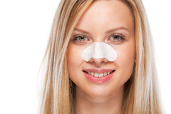 Portrait of smiling teenage girl with clear-up strips on nose Stock Photography