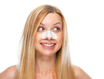 Portrait of smiling teenage girl with clear-up strips on nose Royalty Free Stock Photos