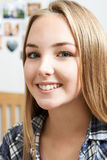 Portrait Of Smiling Teenage Girl At Home Stock Photo