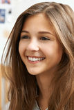 Portrait Of Smiling Teenage Girl At Home Stock Photography