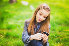 Portrait of smiling teenage girl with mobile phone Royalty Free Stock Images