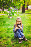 Portrait of smiling teenage girl with mobile phone Stock Images