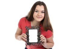Portrait of smiling teenage girl with photo frame. On white background Stock Photo