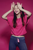 Portrait of smiling teenage girl in pink Stock Images