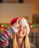 Portrait of smiling teenage girl in santa hat Royalty Free Stock Image