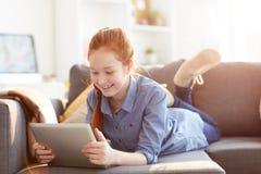 Teenage Girl Using Tablet royalty free stock image