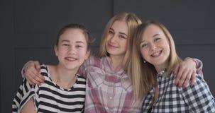 Happy teenage girls with arm around. Portrait of smiling teenage girls with arm around stock footage