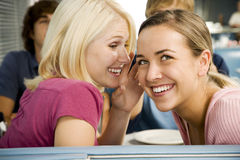 Portrait of smiling teenage girls with her friends in a diner Royalty Free Stock Photos