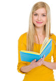 Portrait of smiling teenage student girl with book Stock Photography