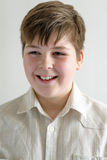 Portrait of smiling teenager boy in a bright shirt Royalty Free Stock Photo