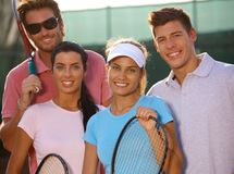 Portrait of smiling tennis team Stock Photography