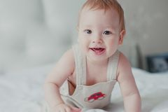 Portrait of a smiling toddler on bed stock images