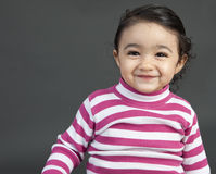 Portrait of a Smiling Toddler Girl Stock Photos