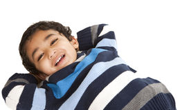 Portrait of a Smiling Toddler Lying on Floor. Isolated, White royalty free stock images