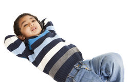 Portrait of a Smiling Toddler Lying on Floor. Isolated, White stock images