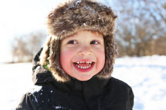 Portrait of smiling toddler walking in winter outdoors Royalty Free Stock Image