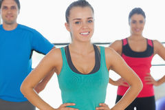 Portrait of smiling toned people at yoga class Royalty Free Stock Photography
