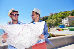 Portrait of a smiling tourist with map and bag.  Stock Photo