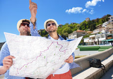 Portrait of a smiling tourist with map and bag.  Stock Photography