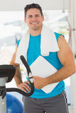 Portrait of a smiling trainer with clipboard in gym. Portrait of a smiling trainer with clipboard standing in the gym Stock Photography