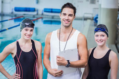 Portrait of smiling trainer and swimmers. At the leisure center Royalty Free Stock Images