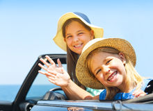 Portrait of smiling two children at beach in the car. Holiday an Royalty Free Stock Photo