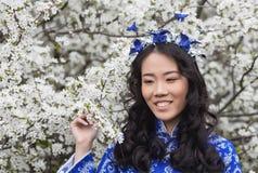 Portrait of Smiling Vietnamese girl in Ao Dai Stock Photo