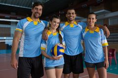 Portrait of smiling volleyball players Royalty Free Stock Photography