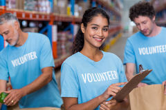 Portrait of smiling volunteer holding clipboard Stock Photography