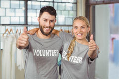 Portrait of smiling volunteers giving thumbs up Stock Photos